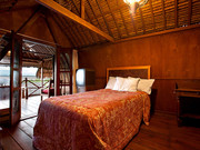 the bungal;ow features 2 single beds perfect for kids also has a master bathroom with shower .
